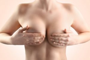 Woman Holding Both Breasts